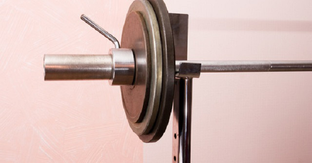 A barbell racked on a bench.